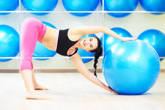 Woman doing warm up fitness ball exercise Stock Photography