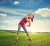 Woman doing warm-up at outdoor Stock Photo