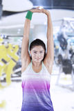 Woman doing warm up by stretching her hands Royalty Free Stock Photos