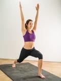 Woman doing warrior yoga position Stock Image