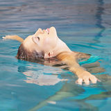 Woman doing water yoga for relaxation Royalty Free Stock Images