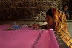 Woman doing weaving stock photos