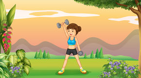Woman doing weighlifting in the park Royalty Free Stock Photo
