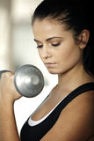 Woman doing weight training Stock Images