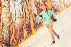 Woman doing winter jog in morning Stock Image