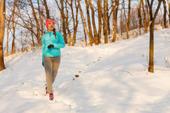 Woman doing winter jog in morning Royalty Free Stock Photography