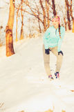 Woman doing winter jog in morning Royalty Free Stock Photo