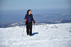 Woman doing winter trekking in the mountains Royalty Free Stock Image