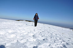 Woman doing winter trekking in the mountains Royalty Free Stock Photos