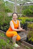 Woman doing work in her garden Stock Images