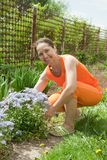 Woman doing work in her garden Royalty Free Stock Images