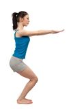 Woman doing workout. Full body shot of a woman doing workout or yoga isolated on white Stock Image
