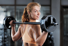 Woman doing workout with barbell Stock Photography
