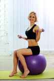 Woman doing workout with dumbbells Stock Photo