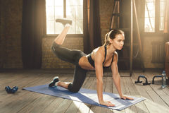 Woman doing workout at home stock photo