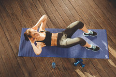 Woman doing workout at home stock photography