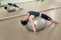 Woman Doing Workout on a Yoga Ball Royalty Free Stock Photos
