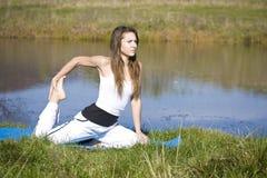 Woman doing yoga Stock Image