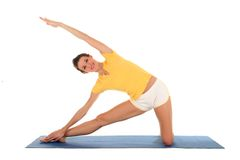 Woman doing yoga. Woman Stretching On A Yoga Mat Stock Images