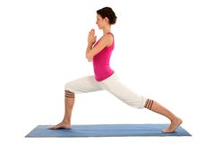 Woman doing yoga. Woman Posing On A Blue Yoga Mat Royalty Free Stock Photos