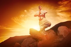 Woman doing yoga against sunrise Stock Photography