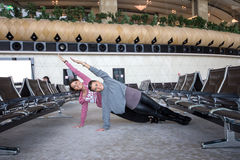 Woman Doing Yoga in airport Royalty Free Stock Photography