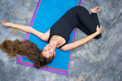 Woman Doing Yoga Ardha Jathara Parivarttanasa Royalty Free Stock Images