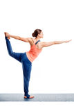 Woman doing yoga asana Natarajasana Royalty Free Stock Images