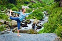 Woman doing yoga asana outdoors at waterfall Royalty Free Stock Photos