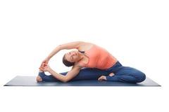 Woman doing yoga asana parivrtta janu sirshasana Stock Photo