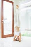 Woman doing yoga asana in a spacious studio Stock Photos