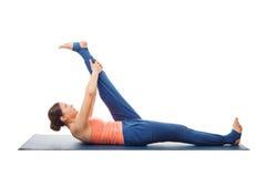 Woman doing Yoga asana Supta padangusthasana isolated Stock Photography