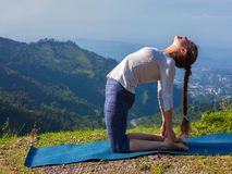Woman doing yoga asana Ustrasana camel pose outdoors. Yoga - outdoors young beautiful slender woman yoga instructor doing camel pose Ustrasana asana exercise Royalty Free Stock Photos