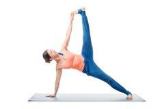 Woman doing yoga asana Vasisthasana variation Royalty Free Stock Photos