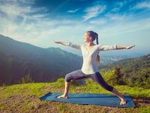 Woman doing yoga asana Virabhadrasana 2 - Warrior pose outdoors Stock Images