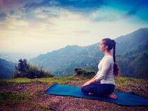 Woman doing Yoga asana Virasana Hero pose Stock Images
