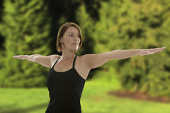 Woman doing Yoga Asana Warrior Pose Royalty Free Stock Photos