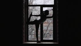 Woman doing yoga asana on window sill. Woman doing yoga asana on window stock video
