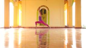 Woman doing yoga in ashram. stock video footage