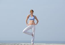 Woman doing yoga balance exercise Royalty Free Stock Photography