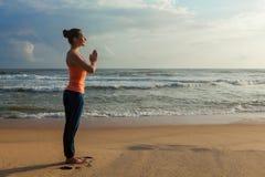 Woman doing yoga on beach royalty free stock photos