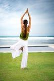 Woman doing yoga on beach Stock Photos