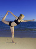 Woman doing yoga on the beach Royalty Free Stock Images