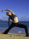 Woman doing yoga on the beach Royalty Free Stock Photography