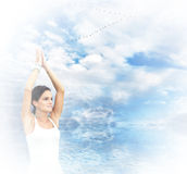 Woman doing yoga at the beach Stock Image