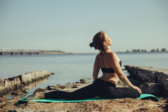 Woman doing yoga on the beach Royalty Free Stock Image