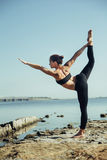 Woman doing yoga on the beach Royalty Free Stock Photo