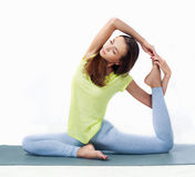 Woman doing yoga. Beautiful slim woman doing yoga, isolated against white background Stock Photo