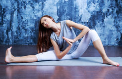 Woman doing yoga Stock Photography