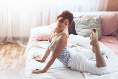 Woman doing yoga in the bed Stock Images